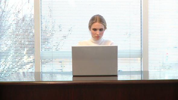 Thumbnail for Professional Female Using Laptop Looks Up And Smiles (2 Of 2)