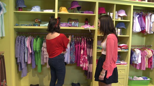 Thumbnail for Women Looking At Different Items At A Children's Boutique (3 Of 4)