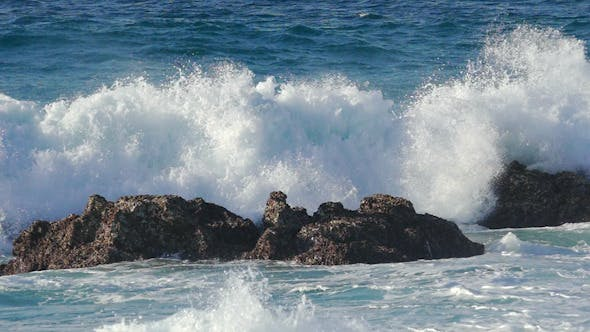 Cover Image for Waves Crashing on Stone Beach