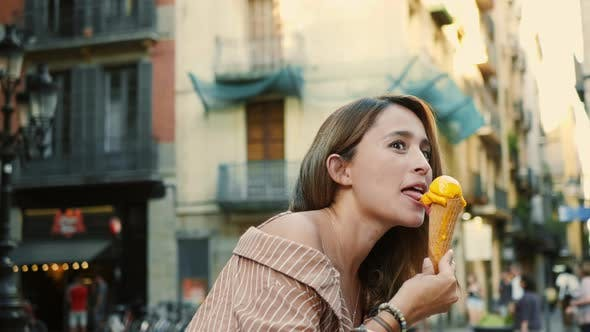 Thumbnail for Cheerful Woman Licking Icecream Outdoor. Cute Girl Eating Melting Ice Cream