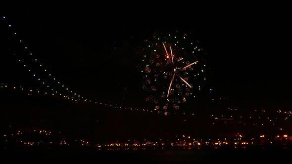 Thumbnail for Firework at Night near Illuminated Bridge