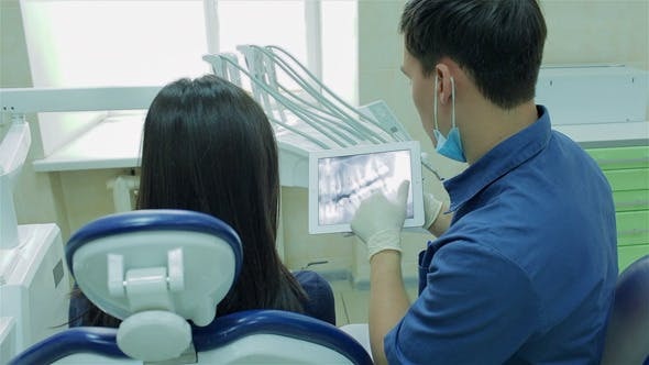 Thumbnail for Dentist Shows At Tablet Image Of Healthy Teeth
