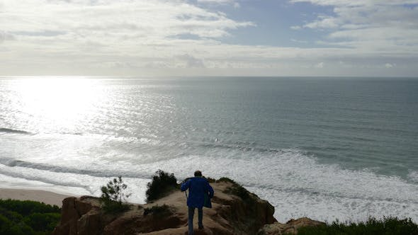 Thumbnail for Man Climb on a Cliff Above the Ocean