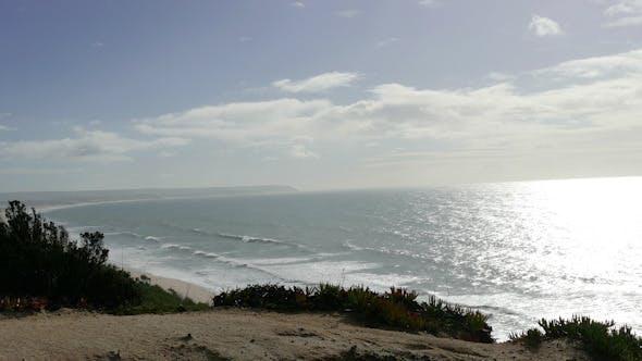 Thumbnail for Man Climb on a Cliff Above the Ocean
