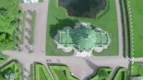 Flying over ancient building and pond in Tsaritsyno