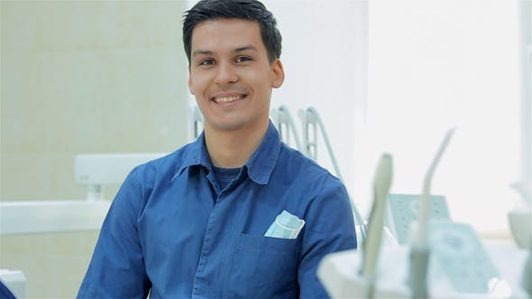 Cover Image for Dentist Smiling Before Taking The Patient