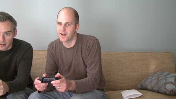 Thumbnail for Two Men Playing A Video Game In The Living Room (2 Of 5)