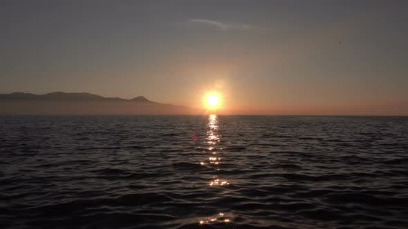 Foggy Mountains And Ocean In Sunset