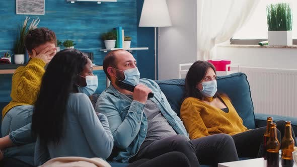 Group of Multi Ethnic Friends Watching a Horror Movie on Tv