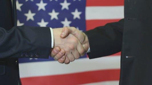 Thumbnail for American Businessmen Shaking Hands