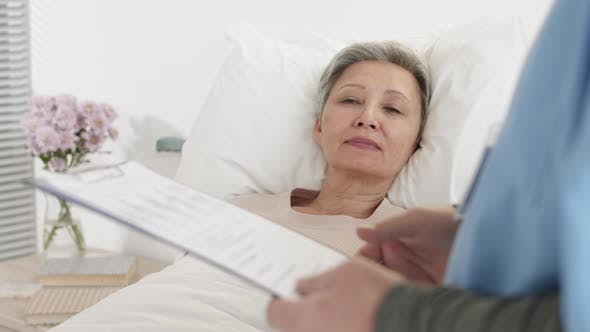 Doctor Talking to Aged Female Patient