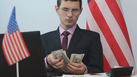 Thumbnail for American Businessman Counts Money