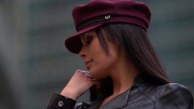Portrait of a Brunette in a Burgundy Cap