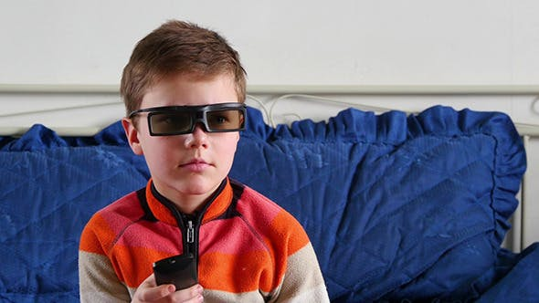 Thumbnail for Little Boy With 3D Glasses And Remote Control