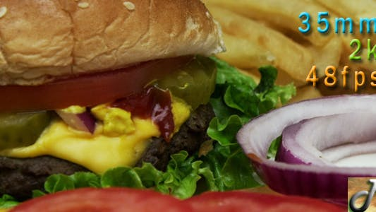 Thumbnail for Cheeseburger With Onions Fries And Tomatoes