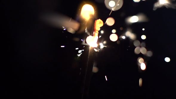 Thumbnail for Sparkler Being Ignited In Slow Motion 7