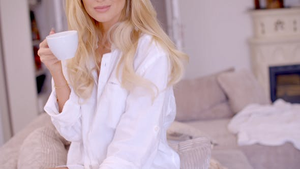 Thumbnail for Alluring Blond Woman With Coffee Looking At Camera 2