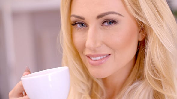 Thumbnail for Attractive Blond Woman Enjoying A Hot Beverage 2