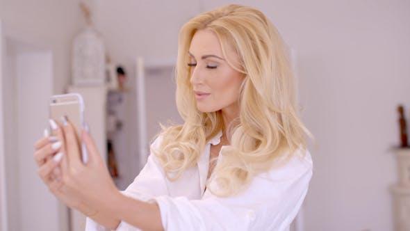 Gorgeous Blond Woman Taking Selfie Photo 2