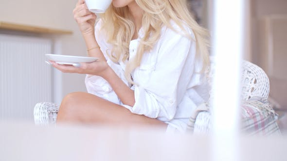 Thumbnail for Happy Blond Woman In White Drinking Coffee 3
