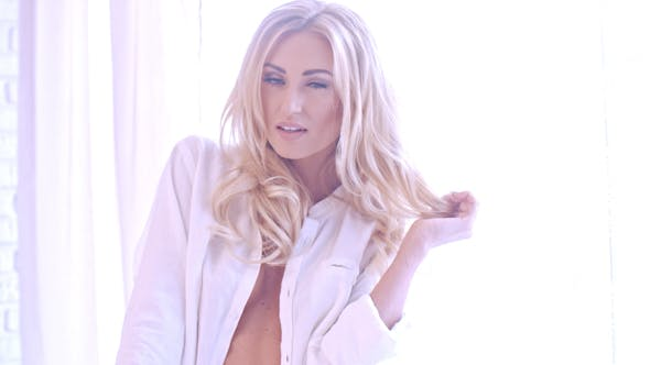 Thumbnail for Seductive Blond Woman In White Looking At Camera 1