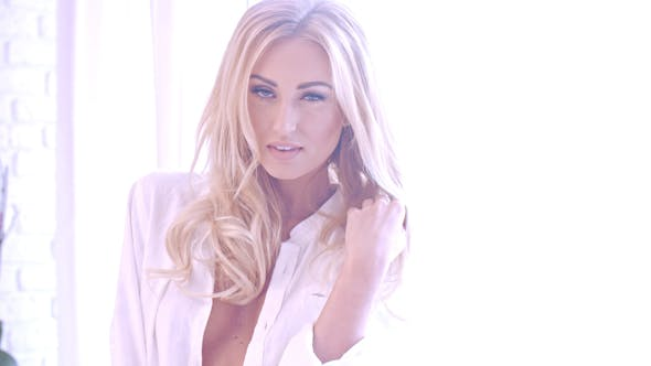 Thumbnail for Seductive Blond Woman In White Looking At Camera 2