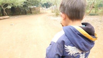 Poor Little Boy Walking