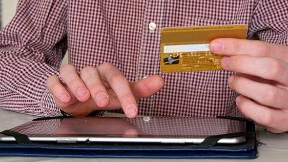 Thumbnail for Shopping Online With Credit Card On Digital Tablet