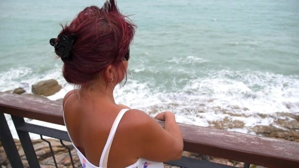 Thumbnail for Middle-Aged Woman On Balcony Over Sea
