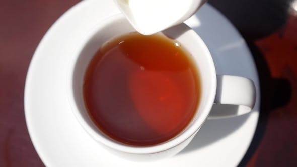 Thumbnail for Close Up Of Pouring Milk Into a Cup Of Tea. Slow