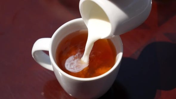 Thumbnail for Pouring Milk From Porcelain Milk Jug Into Cup With