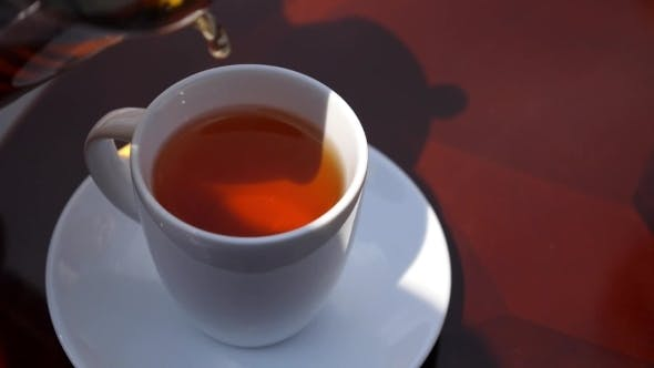 Thumbnail for Pouring Black Tea In The Cup Outdoor