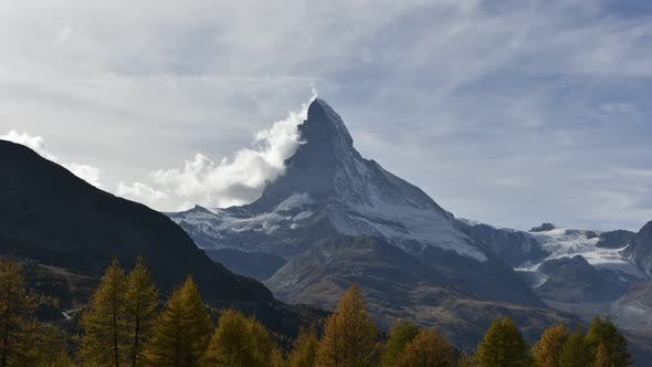 Thumbnail for Picturesque View of Matterhorn Peak and and Orange Autumn Forest in Swiss Alps