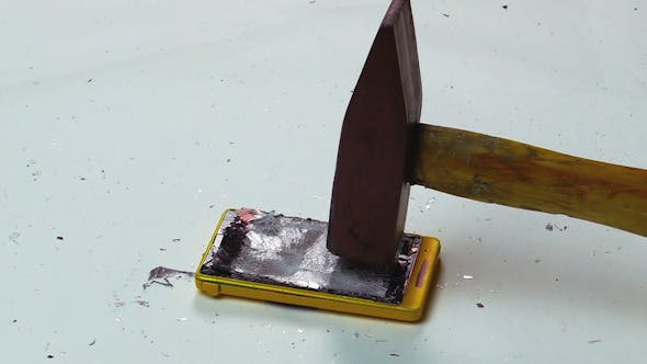 Thumbnail for Destruction of a Cell Phone with a Hammer