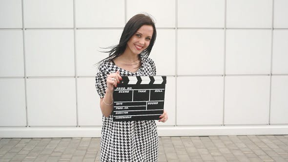 Thumbnail for Girl With Cinema Slate Board Posing