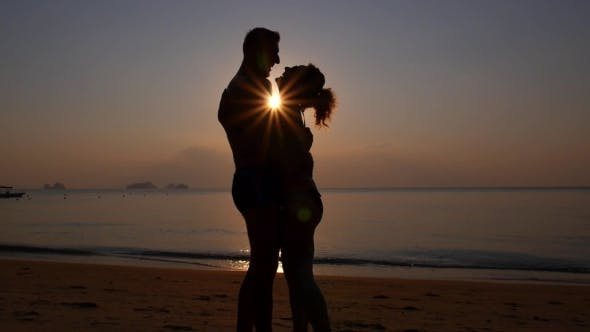 Thumbnail for Romantic Couple Kissing On The Beach At Colorful
