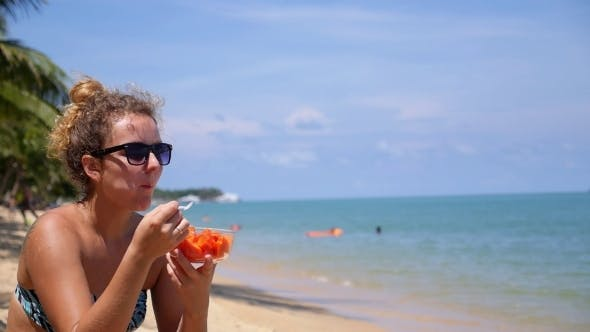 Thumbnail for Healthy Lifestyle - Female At Beach Eating Fruits