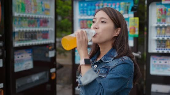 Thumbnail for Woman Bought a Bottle of Juice on Vending Machine