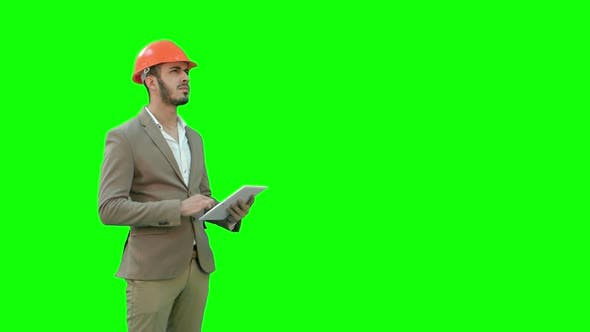 Thumbnail for Engineer in Safety Helmet Conducting Inspection with Tablet on a Green Screen, Chroma Key