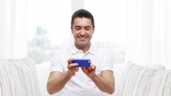 Thumbnail for Happy Man With Smartphone At Home