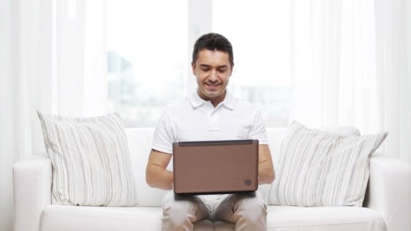 Thumbnail for Happy Man Working With Laptop Computer At Home