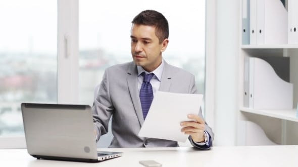 Thumbnail for Smiling Businessman With Laptop And Papers