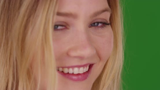 Cover Image for Close up of smiling happy millennial blonde woman on green screen