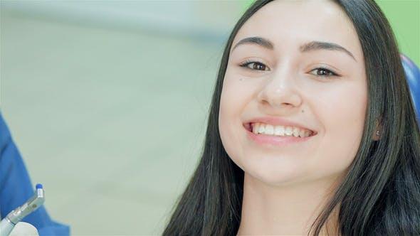 Thumbnail for Cute Girl Teeth Smile Looking At Camera