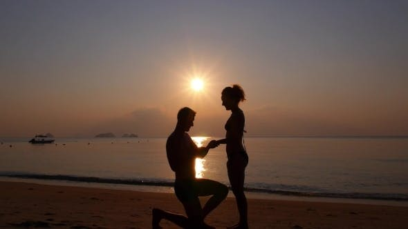 Thumbnail for Sunset Marriage Proposal On The Beach On Vacation