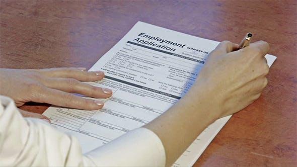 Woman Filling Employment Application
