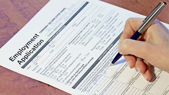 Person Filling Employment Application