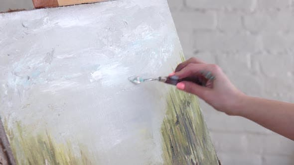 Thumbnail for Artist Smears Paint on Canvas Using Spatula for Oil Paints