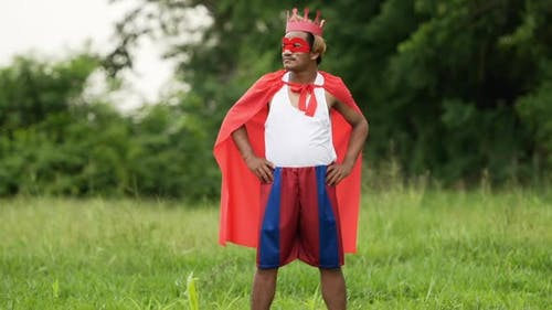 Hero man in red with crown standing