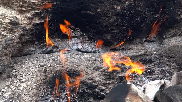 Thumbnail for Flame of Methane Underground Emerges From Crack Between Rocks and Burns to Earth